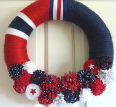 Hey, I found this really awesome Etsy listing at http://www.etsy.com/listing/152987723/patriotic-yarn-wreath-in-red-white-and
