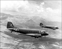 Photo of two Douglas C-47 Skytrain aircraft. My Dad flew these in the China Burmra India campaign, attached to the ATC -Air Transport Command, flying from the Assam Plateau in India, over the Himalayas (The Hump) to Chunking, China. His expression was 'Guns, goats & gasoline' They kept China supplied with whatever was required after the Japanese closed The Burma Road.