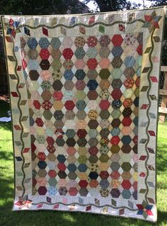English paper piecing quilt for our guest room twin bed.