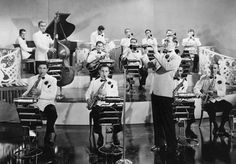 Photograph:Called the King of Swing, clarinetist and bandleader Benny Goodman (center right) popularized big-band jazz in the 1930s.
