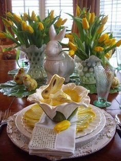 Spring Tablescape in green and yellow - tulips, white and yellow dishes. Tge gold chocolate bunnies are a cute detail!