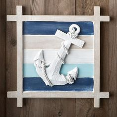 Accent your home with this seafaring wall decor that features a three-dimensional anchor motif. Set on a blue-and-cream striped background, the soft hues of this wall decor are reminiscent of the brea