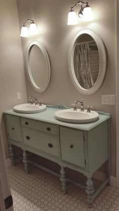 Custom vanity made from antique buffet. Drawers and cabinets work. Drop in kohler sinks. Gorgeous!