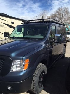Blue, with Black out bumpers, grill, mirrors, Aluminess rack and Advanced rear door ladder. 4x4 Van Conversion, Nissan Vans, Winch Bumpers, 4x4 Off Road, Four Wheel Drive, Roof Rack, Chevy Trucks, Adventure Travel, Jeep
