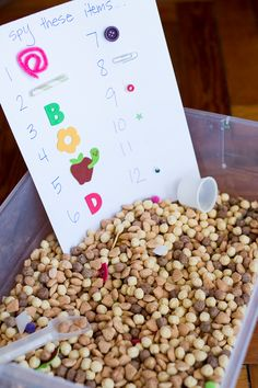 """""""I Spy"""" never gets old! And using it adds counting (and even addition) to a simple cereal sensory bin for preschooler to practice counting."""