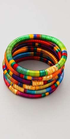 Great colorful striped bangle set.  I can totally see this with jeans and a t-shirt or how about with a white sundress?!