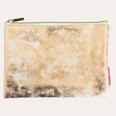 Metallic rose-gold lends subtle glimmer to a glamorous, sleek cosmetic purse that is ideal for travel or daily use, stowing the essentials for beauty on-the-go.