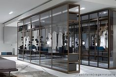 Freestanding closet system, Ego by Poliform.  You can have your closet in the master bedroom.  Pretty.