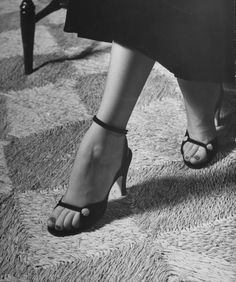 Fashion Extremes  Naked sandal by Julianelli has sparse velvet straps that give it a barefoot look.  Location:New York, NY, US  Date taken:October 3, 1949  Photographer:Nina Leen