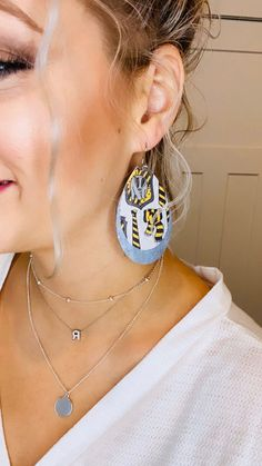 Harry Potter leather earrings | Hufflepuff earrings | Hufflepuff Fall Jewelry, Charm Jewelry, Animal Print Earrings, Harry Potter Jewelry, Leather Gifts, Jewelry Companies, Leather Earrings, Teardrop Earrings, Beautiful Earrings