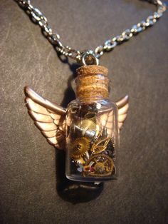 Steampunk Time in s Bottle Necklace with Gears and Copper Wings (392). $ 30.00, via Etsy.