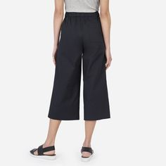 With a wide leg and cropped length, this crisp cotton poplin culotte transitions easily from day to night. It features a covered elastic waistband, two slant pockets, and one rear patch pocket. The fabric is a crisp, structured cotton with a bit of stretch.