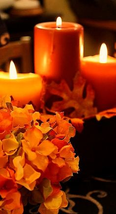 Autumn candles and flowers