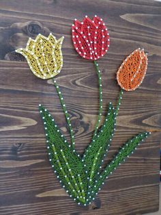 String Art DIY Kit. Yellow, Red, and Orange Tulips. Home Decor. Flower Decor. Tulip Decor. DIY Decor. DIY Crafts String Art Crafts. Click on the picture to find out more about how you can make this DIY String Art Tulip yourself More