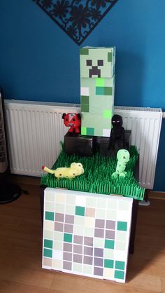 Creeper with a few minecraft animals, the cat is chasing the creeper :)