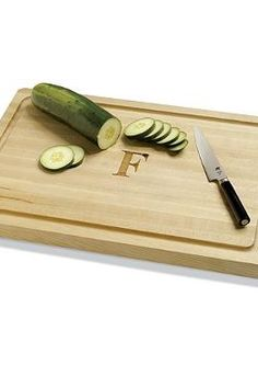Personalize your cooking experience with the Monogrammed Maple Cutting Board that's constructed of solid strips of durable maple wood and will quickly become an entertaining essential.
