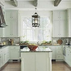 Rustic beams, lantern lighting, painted cabinets I love country kitchens