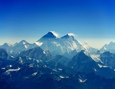 Mount Everest - Nepal/China  ~ located in Himalayas, is the highest mountain, with a peak at 8,848 metres (29,029 ft) above sea level. This is where earth meets the sky :)