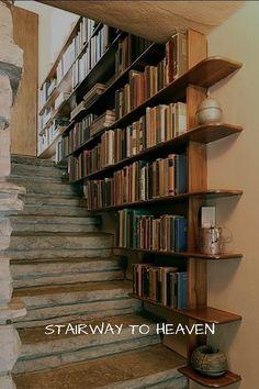 Staircase bookshelf - DIY Bookshelves : 18 Creative Ideas and Designs. Yes, I have seen a few DIY versions of the staircase bookshelf, wonderful design idea. Staircase Bookshelf, Bookshelf Ideas, Creative Bookshelves, Book Stairs, Stair Shelves, Bookshelf Decorating, Cheap Bookshelves, Decorating Ideas, Bookshelf Design