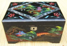 I had a musical Japanese/Chinese jewellery box, complete with twirling ballerina inside.