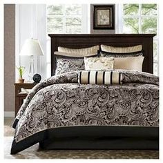 """If classic is your style, Charlotte is perfect for you. The jacquard weave is inspired from an updated paisley motif and is woven into a beautiful combination of deep black, gold and a hint of platinum for a touch of sheen to your bedding. The comforter and shams offer beautiful details with a 2"""" flange and 1/2"""" flat piping in a soft gold. The reverse of the comforter is a rich taupe color. The sheets are 100% cotton, 200 thread count, and the light khaki coordinates back perfe..."""