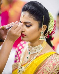 South Indian bride. Gold Indian bridal jewelry.Temple jewelry. Jhumkis.Yellow silk kanchipuram sari.Braid with fresh jasmine flowers. Tamil bride. Telugu bride. Kannada bride. Hindu bride. Malayalee bride.Kerala bride.South Indian wedding.