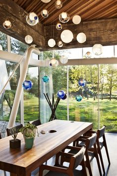 I just love these glass balls...might look neat as a room divider over my half wall...hmmmmmm.