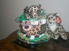 Leopard Cake: Here are four different coordinating diaper cakes that are AMAZING accents for a darling jungle baby shower! Each diaper cake features a different animal