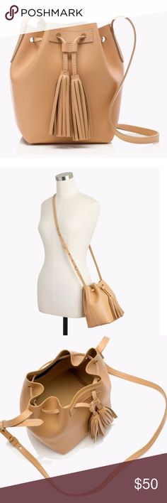 J Crew Mini Bucket Bag in Leather Smooth, structured leather bucket bag with tassel drawstring closure and a handy interior pocket.  Genuine leather. Condition: New J. Crew Bags Crossbody Bags