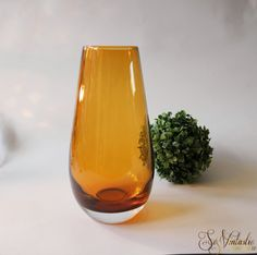 Cased #amber_glass vase, wonderful modern sleek design. Blown art glass vase with the use of the Sommerso technique. Thick and heavy quality glass. Is it Italian - Murano? Swedish - Orrefors? This beauty would look very good in many home decors and would make a good add to one's collection. In very good condition - gift worthy;-). On offer by SoVintastic on Etsy