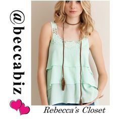 """Darling tiered floral crochet tank in mint   Mint color tiered tank with crochet straps and floral embroidered detailing.   Non-sheer. Unlined. Lightweight. 100% rayon.  Hi Lo style ranging from 25"""" in front and graduates to 28"""" sides to back.  Please see size chart.    No Trades. Boutique Tops Tank Tops"""