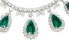 Detail: AN EXCEPTIONAL EMERALD AND DIAMOND NECKLACE, BY HARRY WINSTON. Designed as a line of graduated brilliant-cut diamonds, with twin pear-shaped diamond detail, suspending five detachable pear-shaped emerald and diamond pendants, to the marquise-shaped diamond and pear-shaped emerald pendant clasp, mounted in platinum.