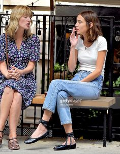 Alexa Chung shares a cigarette with a friend in Soho on September 13, 2016 in New York City.