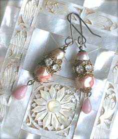 Blush Earrings by sweetruin on Etsy, $60.00These charming earrings are comprised of vintage baroque Miriam Haskell pearls, freshwater pearls and glass teardrops....all in soft shades of blush and pink. There are also ornate rhinestone rondelles and more vintage details. The ear wires are sterling silver.