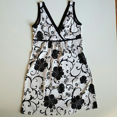 Limited dress black and white flower NWOT The Limited black and white v neck for the front and back. Detailed with flower swirl leaf  with black piping around the neck and waist. Side zipper closer. The Limited Dresses