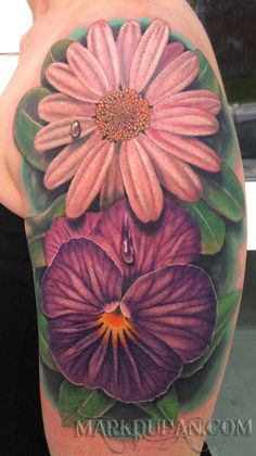 By Mark Duhan : A VIOLET AND A DAISY FOR HER TWO DAUGHTERS ON HER UPPER ARM.