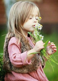 Flowers and girl but could be a bee or cute fuzzy animal with same expression & flowers