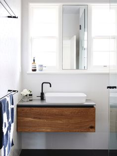 Love the timber, white & black fittings. Vanity needs to go all the way to the floor