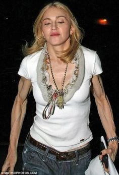 # 9 Madonna Zero percent body fat is a nice idea in theory. But in reality it looks really frightening. Without Hollywood makeup and lighting, it's hard to believe that Madonna is only Madonna, Celebrity Look, Celebrity Pictures, Awkward Moments, Pop Singers, Super Skinny, Being Ugly, Movie Stars, Celebs