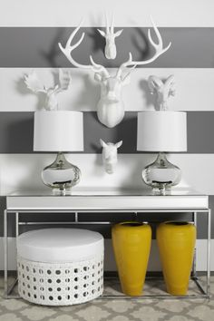 I have a cow skull that I plan to spray paint silver and mount like this.