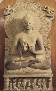 """Seated Buddha preaching first sermon, from Sarnath, India, second half of fifth century. Tan sandstone, 5' 3"""" high. Archaeological Museum, Sarnath."""