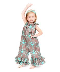 A mesmerizing print dances on this delightful cotton romper. With tiers of ruffles at the ankles and an adjustable drawstring top, it's a stylish way to take on the day.100% cottonMachine wash; tumble dryMade in the USA