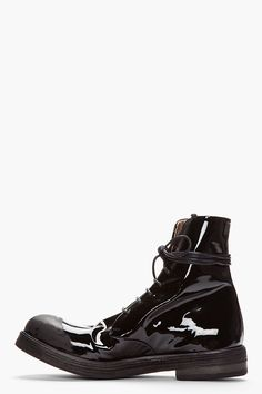 MARSÈLL //  Black Patent Leather Scuffed Lace-Up Boots  32349M047003  High-top patent leather boots in black. Round toe. Black lace up closure. Signature scuffed toe. Black textured foxing. Tone on tone stitching. Leather upper, leather/rubber sole. Made in Italy.  $1020 CAD
