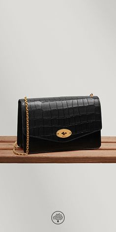 Shop the Darley in Black Deep Embossed Croc Leather at Mulberry.com. A classic clutch, iconic detailing and beautiful deep embossed croc print leather - a combination found in the Darley with its namesake lock closure, elegant detachable chain strap and organised interior in nappa lining.