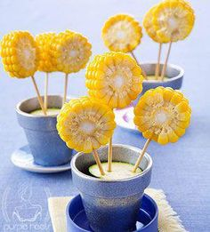 Cut corn-on-the-cob into discs, skewer with shish kabob sticks, and sick into a cucumber in a flower pot.