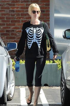 Getting into the Halloween spirit: January Jones donned a skeleton sweatshirt as she stepp...