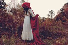 Perhaps a cape in a color other than RED is a better choice when heading into the woods...