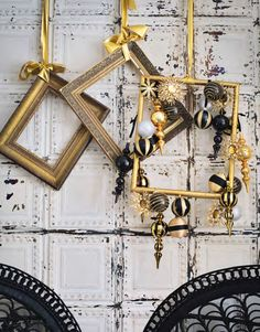 This Christmas decorating idea sees metallic decorations affixed to a selection of empty picture frames. Bring in black accents to further the urban feel. Shown here in a modern dining room, with Tin Tiles wallpaper - div Black Christmas, Modern Christmas, Christmas Crafts, Beautiful Christmas, Gold Christmas Decorations, New Years Decorations, Empty Picture Frames, Christmas Window Display, Navidad Diy