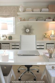 The designer used two Micke drawer/file units and one Micke storage unit (in the middle) from Ikea. Mounted on chrome Besta legs, they were the right height to place beside the Expedits. She topped the whole thing off with the two long surfaces in the Lack TV Unit (her own IKEA hack) which attached together with a brace from Home Depot. The two surfaces were the perfect length and depth for the room. She liked the thickness of the surfaces and the way they visually finished off the built-in.