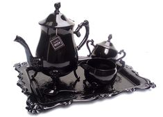 Victorian upcycled tea set - originally a metal Victorian tea set, painted noir by Christine Misiak, via Flickr